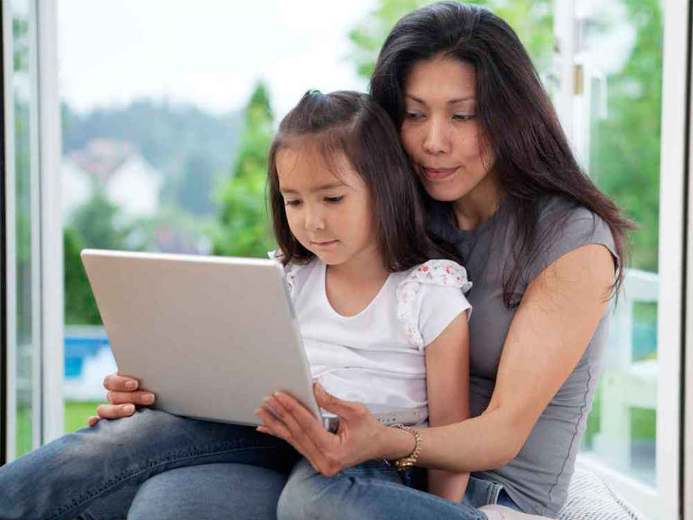 Asian mom and daughter on laptop